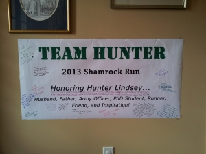 The signed banner now hangs in our hallway!